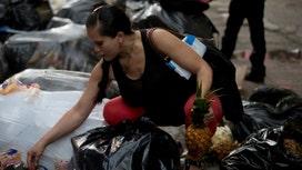 Venezuelans selling trash for cash
