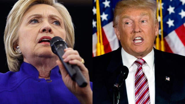 How much is Clinton outspending Trump?