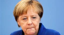Did Merkel commit political suicide?