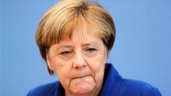 Did Merkel commit political suicide?