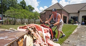 Debris, gutted homes surround Louisiana