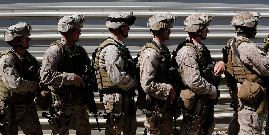 Veterans Sgt. Robert Richmond and Sgt. Bryan Strother on opposition to the Pentagon asking some California National Guard veterans to return their enlistment bonuses.