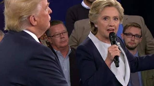 Trump, Clinton clash on economics