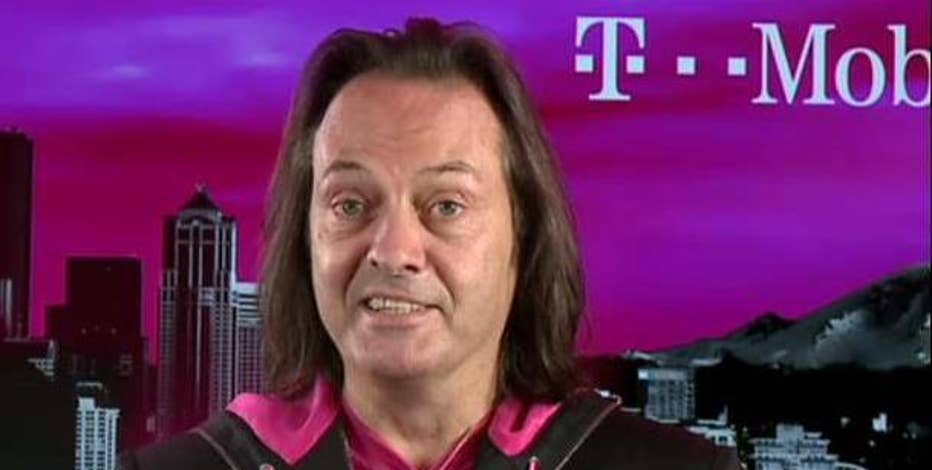 T-Mobile CEO John Legere explains why he believes the AT&T/Time Warner deal will help his business grow.