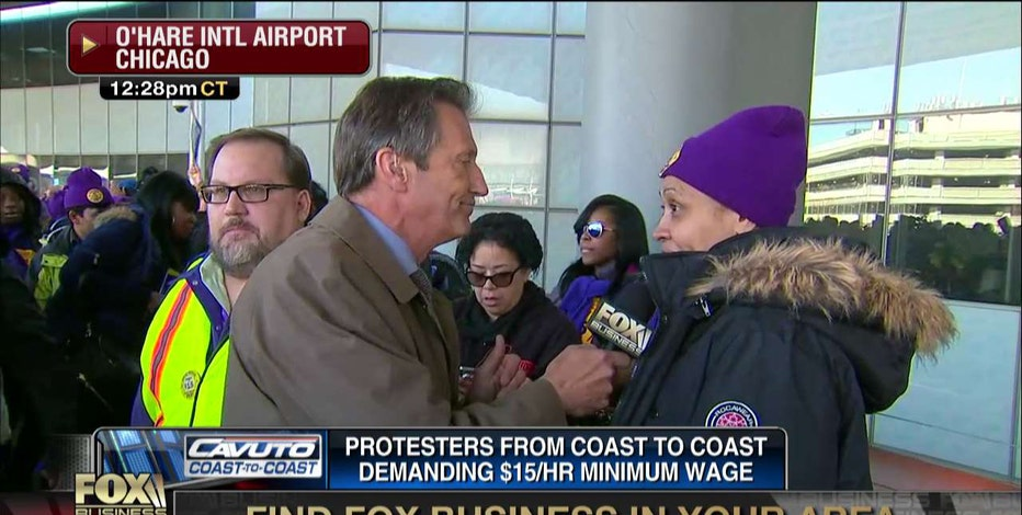 FBN's Jeff Flock confronts a man who allegedly advised a Chicago O'Hare Airport SEIU protester to not speak on live television.