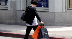 What is driving American consumers to spend more?