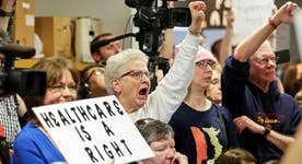 Protests erupt at town halls across the country