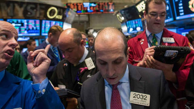 Dow scores 12th-straight record close ahead of Trump speech
