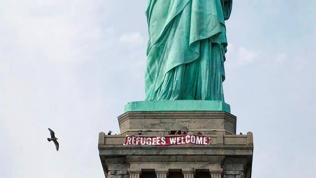 Banner hung on the Statute of Liberty not protected under free speech?