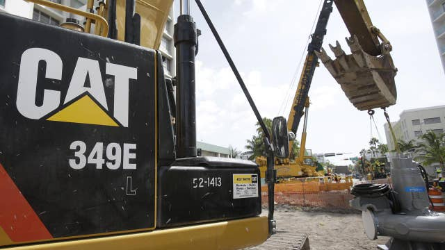 Caterpillar offices searched by Federal agents