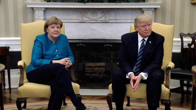 Trump meets Merkel to talk refugee crisis, trade