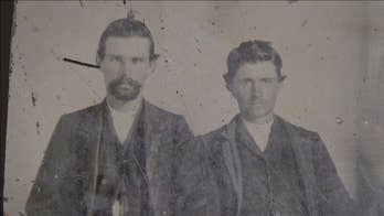 High-tech forensics suggest a family heirloom may be the only photo of the outlaw Jesse James with the man who killed him.
