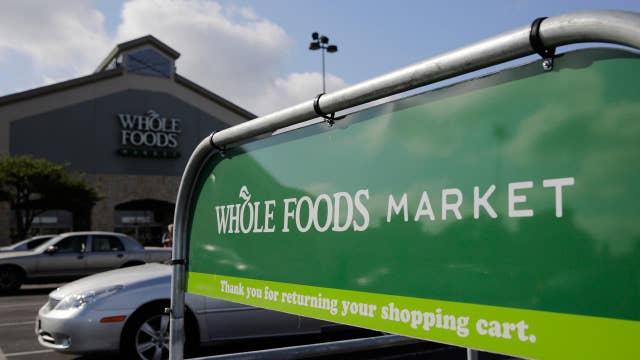 Critics sound anti-trust alarm over Amazon-Whole Foods deal