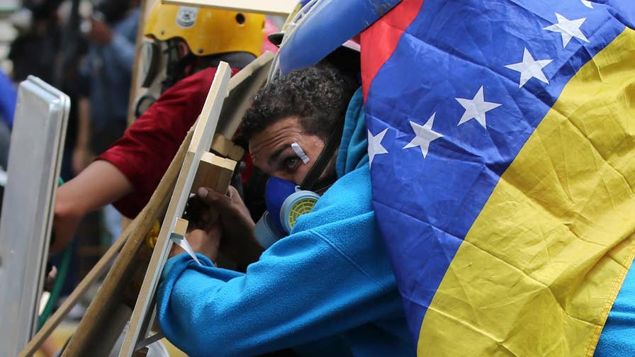 Marxist economist Richard Wolff on how socialism and the price of oil have contributed to the crisis in Venezuela.