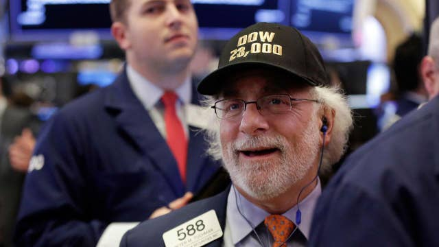 Dow testing record levels after reversing 100-point loss