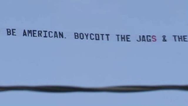 Small business owner flies protest banner over NFL game