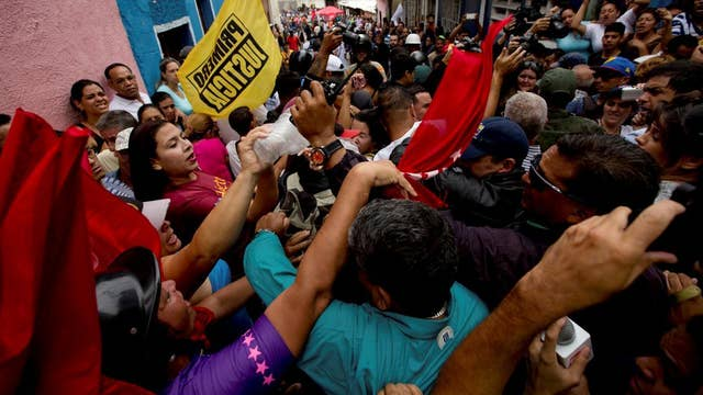 How is the Venezuelan government holding on to power?
