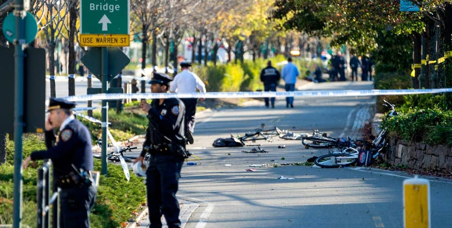 Former New York Police Commissioner Bernard Kerik reacts to a truck driver plowing into pedestrian along the West Side bike path.