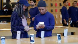 Investors eye Apple iPhone shipping delays
