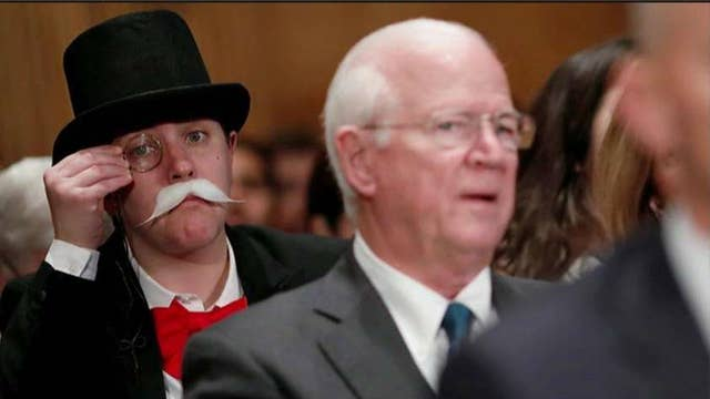 'Monopoly Man' takes on Equifax