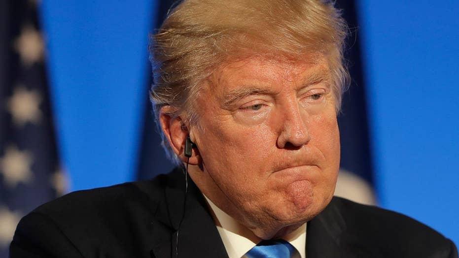 Trump backs Roy Moore despite allegations