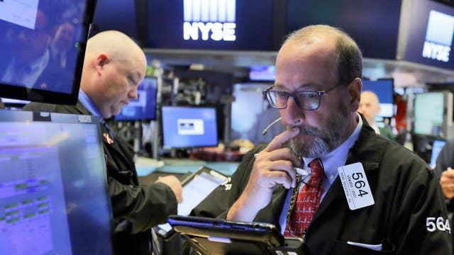 Stock market mixed as financials slide