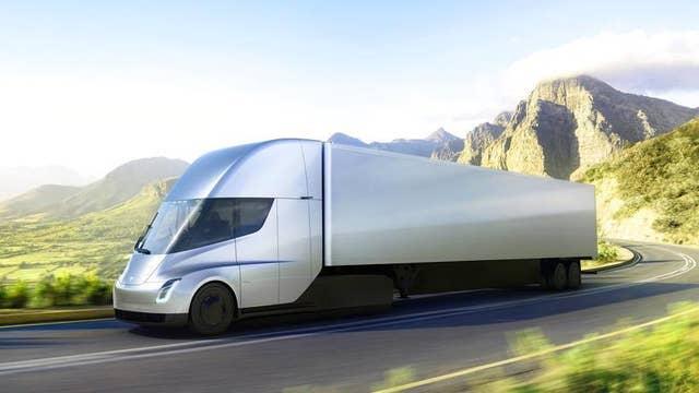 Tesla unveils semi-truck super-fast Roadster