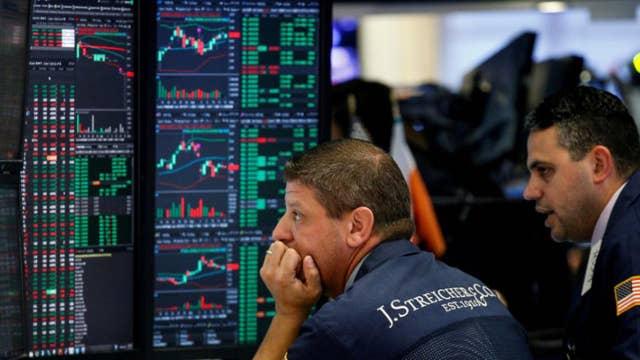 Markets close higher amid tax reform push