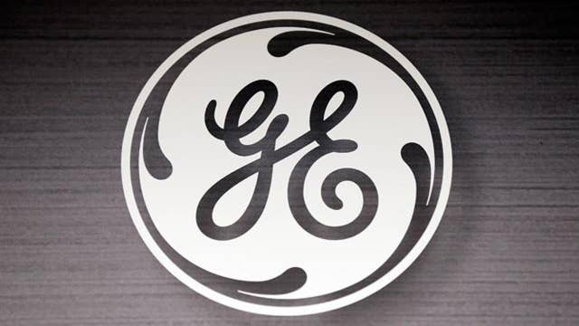 GE slashes dividend in half