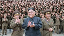 """Kim Jong Un's regime is pursuing an """"aggressive schedule"""" to construct its first operational ballistic missile submarine, an analysis of satellite images indicated as North Korea scoffs at international condemnation and moves to complete its missile and nuclear program."""