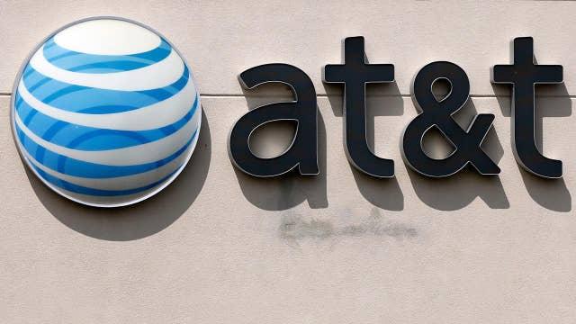 DOJ takes on AT&T-Time Warner deal