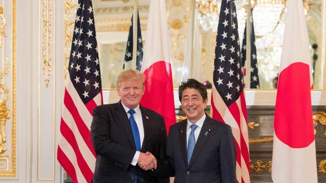 Trump talks tough in Asia