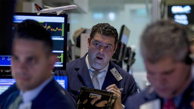 Stocks climb to highs amid merger talk