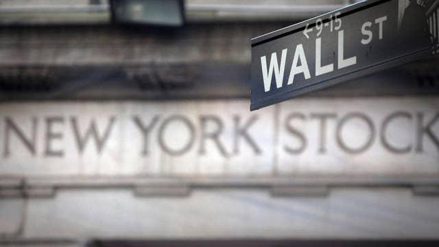 Stocks close at records, Dow nears 25K