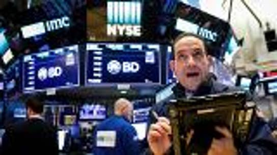 Markets close at records, after Dow dipped Monday