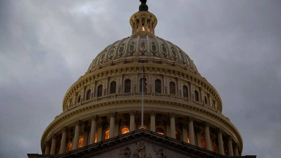 Stocks slide as Congress debates new spending bill