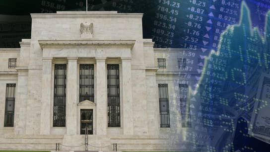 Fed less hawkish on interest rate increases, sees few signs of wage growth