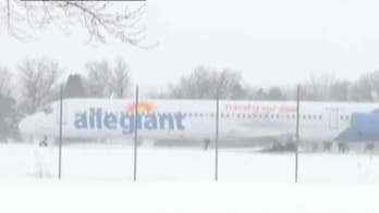 Plane skids off runway in Sioux Falls