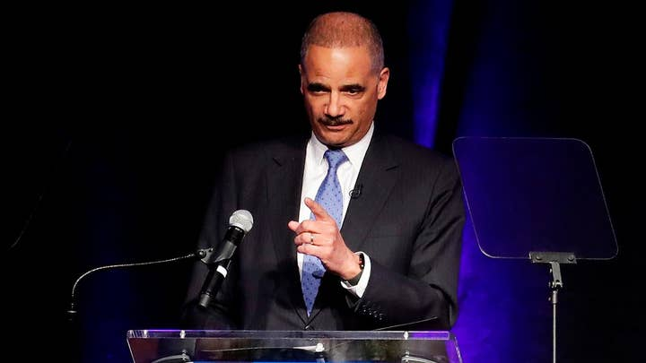 Eric Holder defends DOJ, FBI in tweet