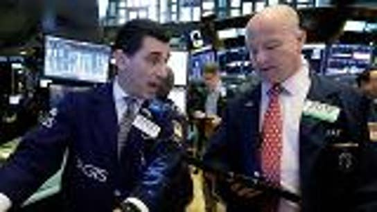 Stocks mostly higher after surging retail sales