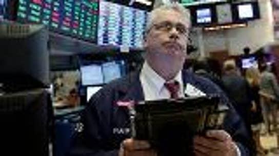 Stocks close slightly higher ahead of North Korea summit