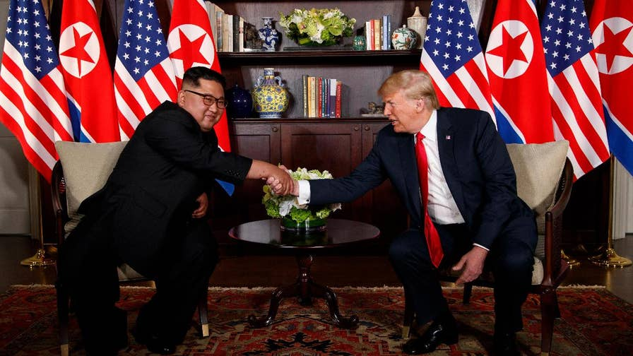 President Trump and North Korea's Kim Jong Un sign a joint document at the nuclear summit.