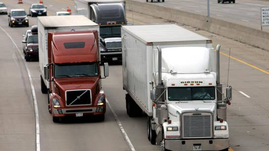 Truck driver shortage throwing wrench into business activity: Fed