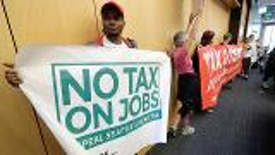 Seattle repeals controversial business tax
