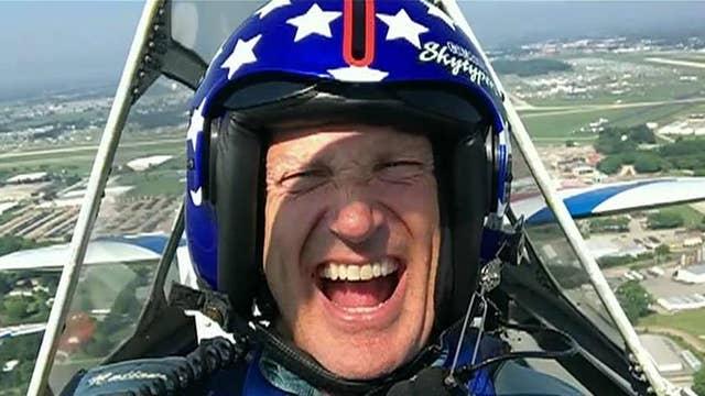 Jeff Flock flies with the GEICO Skytypers Air Team