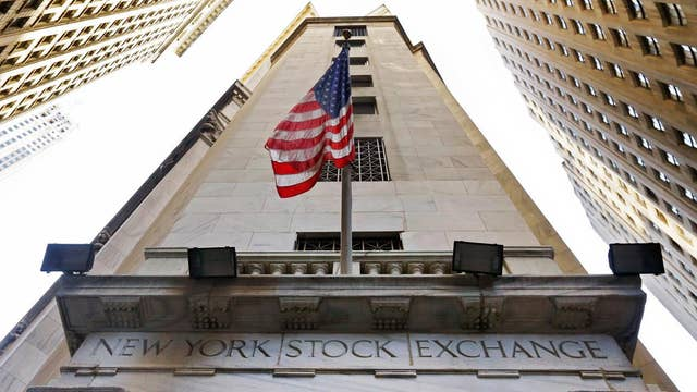 Stocks finish higher as investors shrug off trade issues