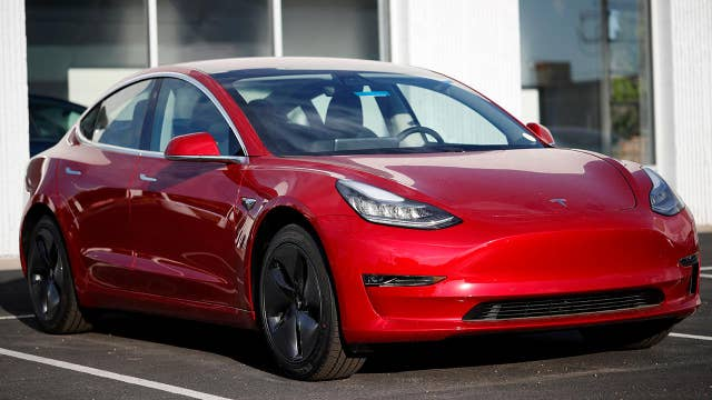 Musk says Tesla reached production goal with its Model 3