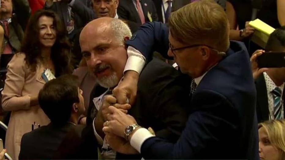 Protester removed from Trump-Putin news conference