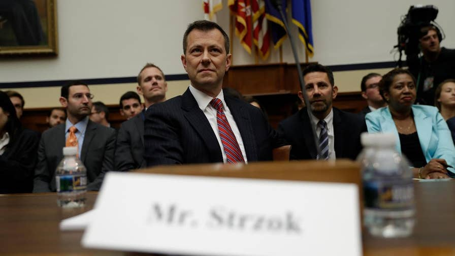 FBI agent Peter Strzok responds to questions from Rep. Trey Gowdy, (R-S.C.), during his testimony on Capitol Hill.