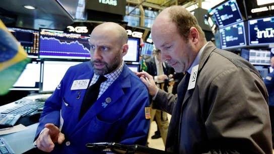 Stocks mostly flat as traders digest corporate news, trade developments